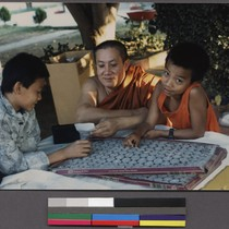 Buddhist monk with two boys, Ceres, California