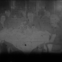 Alice Peters and others gathered around a table