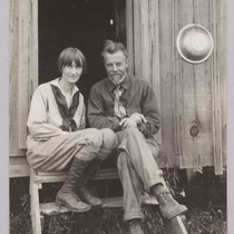 Alfred and Theodora Kroeber sitting on steps of cabin