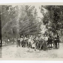 Agricultural laborers standing with shovels
