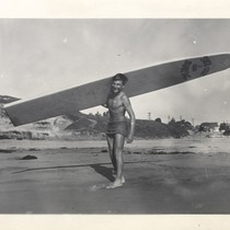 Alex Hokamp carrying surfboard, Harry Mayo, and Harry Murray at Cowell Beach