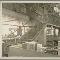 20th Century Market. Oakland. [Interior, staircase with iron railing.]