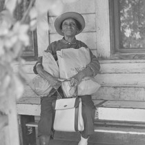 Black woman on porch with groceries, from Walnut Grove: Portrait of A ...