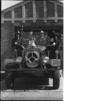 Group photograph of Oakland firefighters on fire truck in front of fire ...
