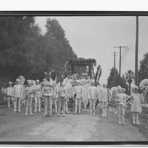 Floats in early Tournament of Roses parade, Pasadena. approximately 1909