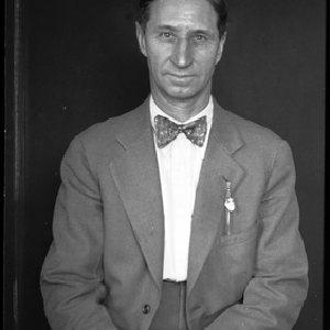 Portrait of man in bow tie and suit