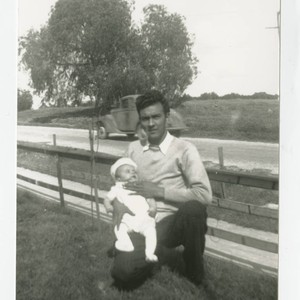 Eulogio Cabral holding Angel in their front yard, South Whittier, California