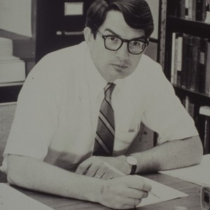 Dave Brant writing at desk, ca. 1967