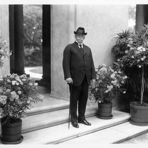 Portrait of Henry E. Huntington on loggia steps, circa 1920
