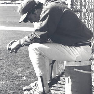 Member of the Chapman College baseball team sitting on the bench