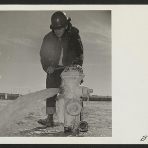 Mike Yoshimine, an evacuee member of the Fire Department, makes a routine ...