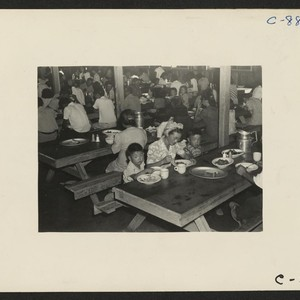 Manzanar, Calif.--Mealtime in one of the mess halls at this War Relocation ...