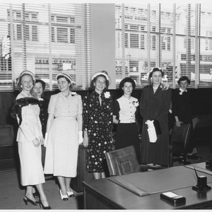 Women posing for a photograph in the American Trust Company offices