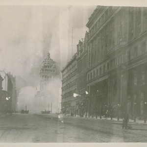 Market St. from Powell, looking east. Fire coming up Market Street; Emporium, ...