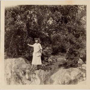 Woman Standing on Edge of Rocks