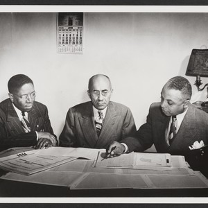 George A. Beavers, William Nickerson, Jr., and Norman O. Houston reviewing Company's ...