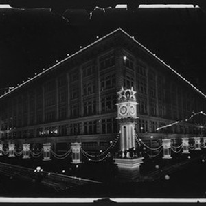 May company building decorated for Shriner's electrical parade, ca.1910