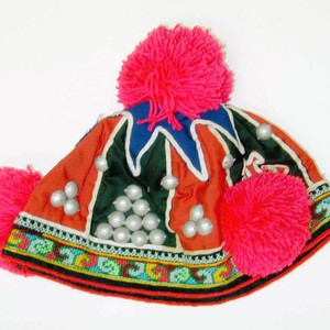 Child's hat with red pompoms