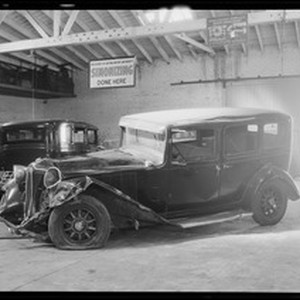 Wrecked Chrysler sedan at 3221 South Figueroa Street, Los Angeles, CA, 1932