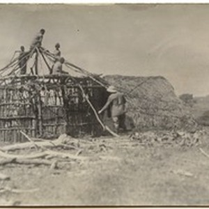 Construction of the first round house at the mission station, Ayra, Ethiopia, ...