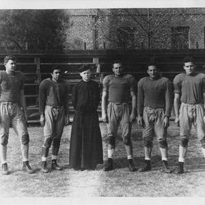 Patrick Conway, S.J., and Loyola football players