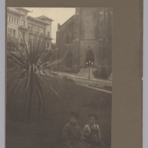 [children sitting on grass in Portsmouth Square]