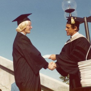 President Banowsky presenting a diploma to a graduate