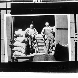 Railroad workers unloading feed at Kenwood