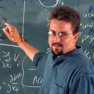 Professor Michael Holst, standing in front of a chalkboard.