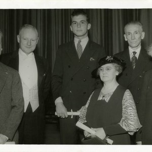 1943 Edith Daley with five men