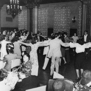 "Dancing the ""hora"" at a wedding celebration"