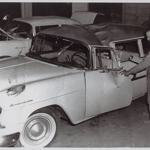 Kenneth R. Torliatt inspects damaged Souza family car, 132 Keller Street, Petaluma, ...
