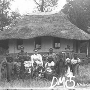 Group of women and little girls in front of a building, South ...