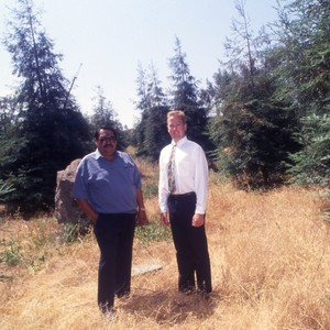 Unidentified faculty member inspecting Redwoods.