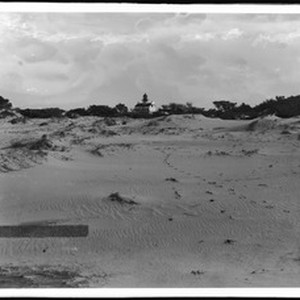 Footprints lead up the beach to the Point Pinos Lighthouse, Monterey County, ...