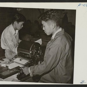 Editor Albert Saijo inspects a copy of Echo, high school paper, being ...