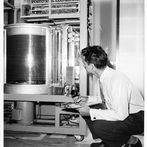 Unidentified Male Inspecting the Core of a Large IBM Data Processing Machine