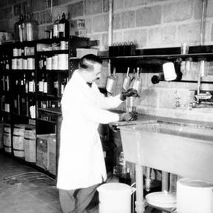 Technician mixing photographic chemicals