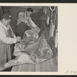 Sam Takeda and George Yoshihara, former west coast butchers, cutting meat for ...