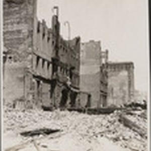 [Ruins and rubble along unidentified street]