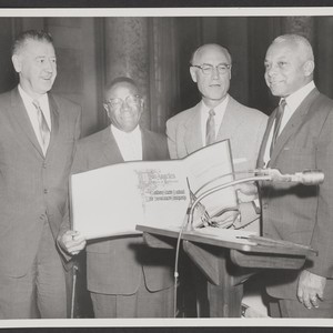 George A. Beavers, Jr. and Norman O. Houston accept proclamation from Los ...