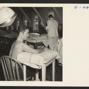 Pvt. Kenichi Kawakami receives physio-therapy treatments at the Moore General Hospital, Swannanoa, ...