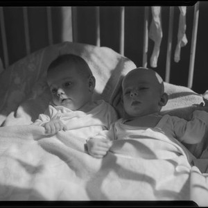 Two babies in crib, Los Angeles, circa 1935