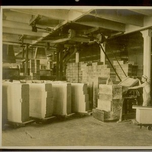 Soap chipping room Soap Dept. Bayonne Refinery showing man feeding soap into ...