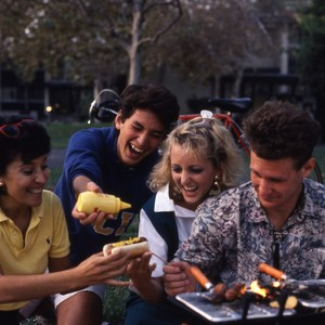 Students barbequing outside of the dorm facilities.