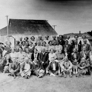 Large group of adults posing for a photo outdoors--possibly the Borba family ...