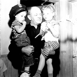 Policeman Herb Vail with two children