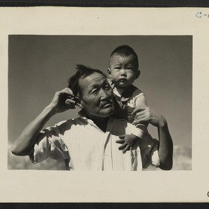 Manzanar, Calif.--Grandfather and grandson of Japanese ancestry at this War Relocation Authority ...