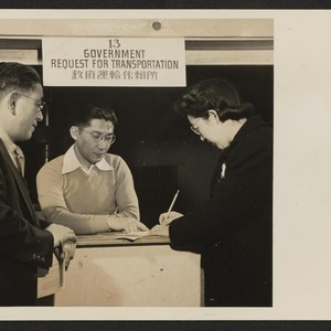 Harry Fuji of the Heart Mountain Relocation Office in charge of transportation, ...