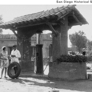 A woman and man in coveralls standing at a Rancho Santa Fe ...